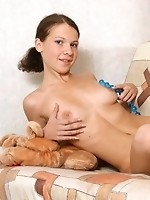 Cutie sits and plays with her stuffed animal and gets naked slowly tiny tits