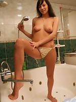 Long haired nubile szilvia having some nice time playing with water in the shower all naked
